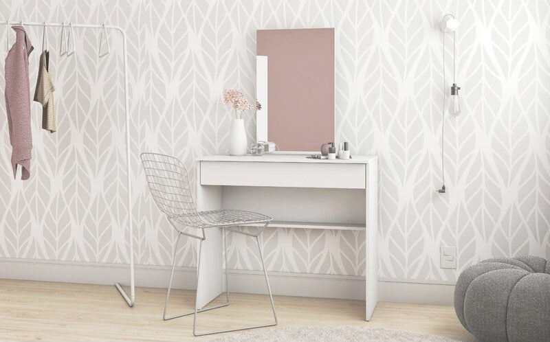 A plain white, square desk with a frameless  rectangular mirror on top that's not as wide as the desk
