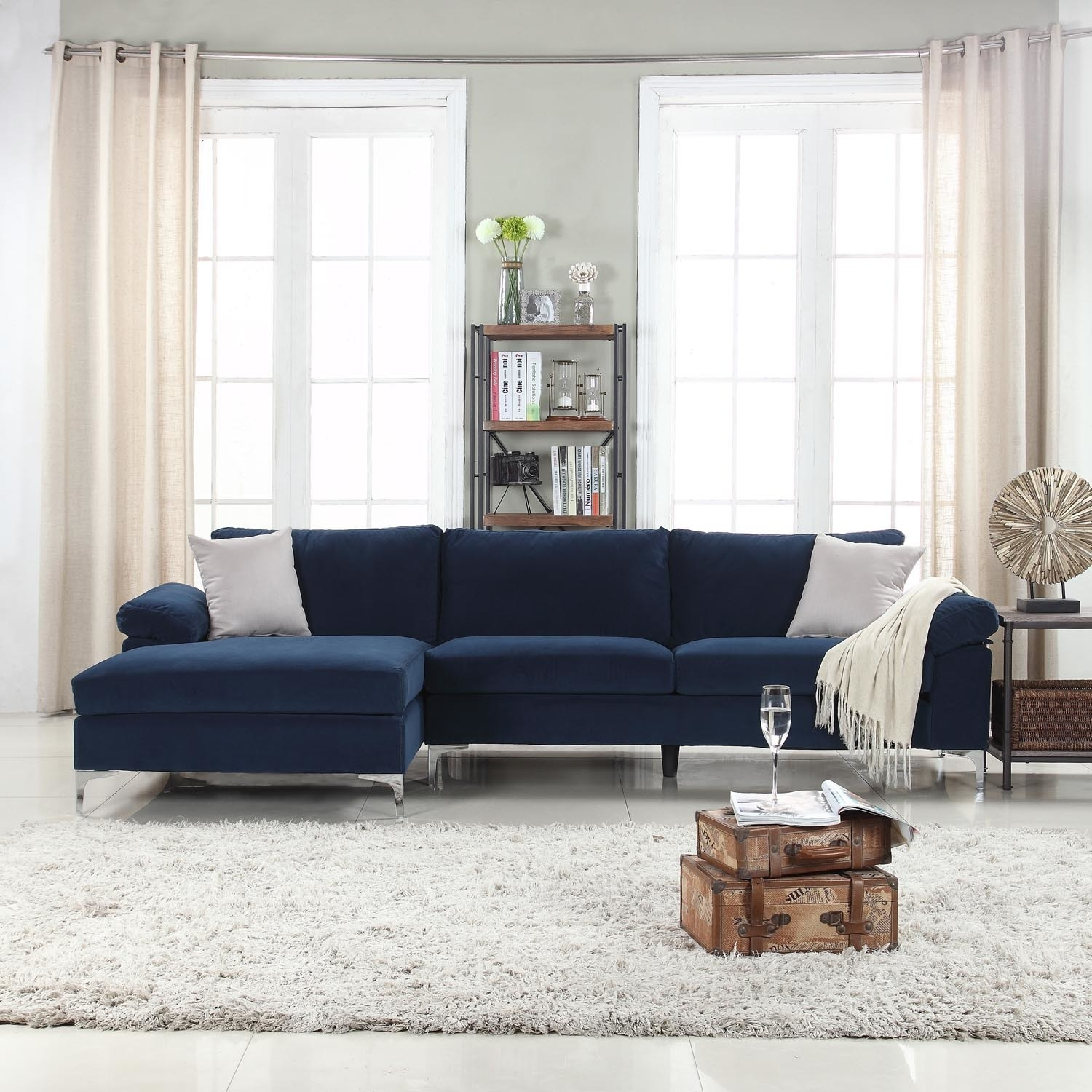 A dark blue sectional sofa with a chaise