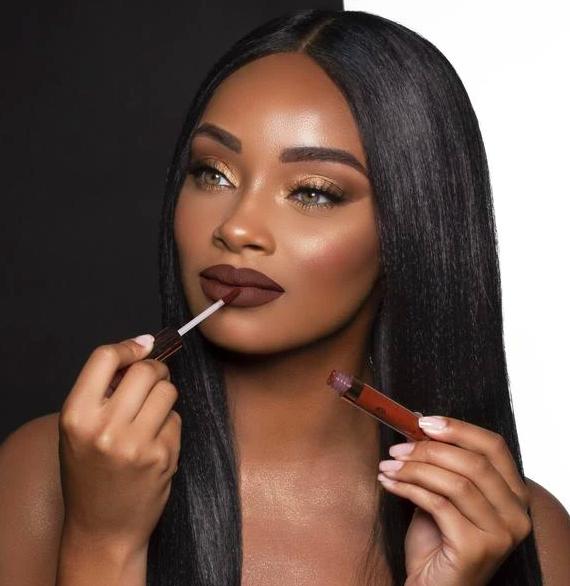 Model applies BH Cosmetics' Liquid Linen Lipstick in a red Giulianna shade