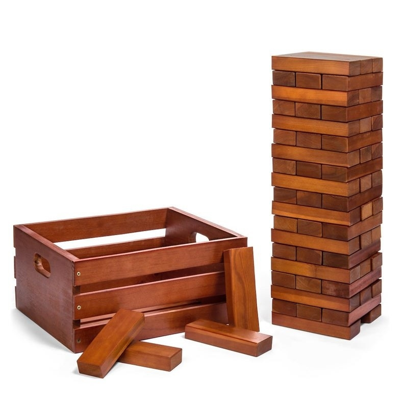 The stackable game stacked tall with a carrying crate to its left