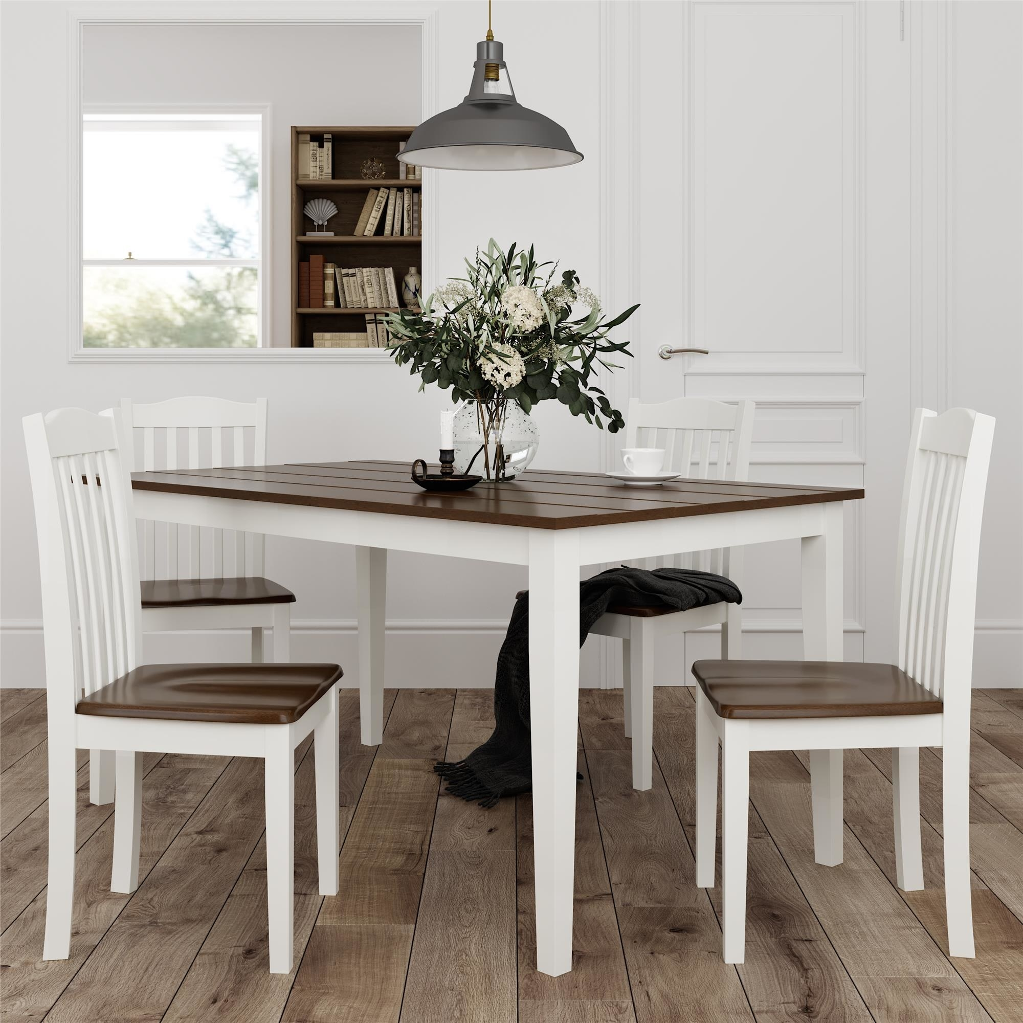 A table and four chairs with brown tops on white wooden frames