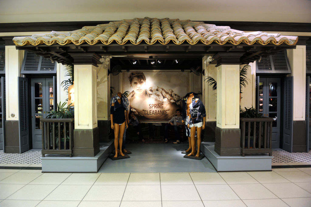 A photo of the exterior of a Hollister store (which has beach house design) inside of a mall