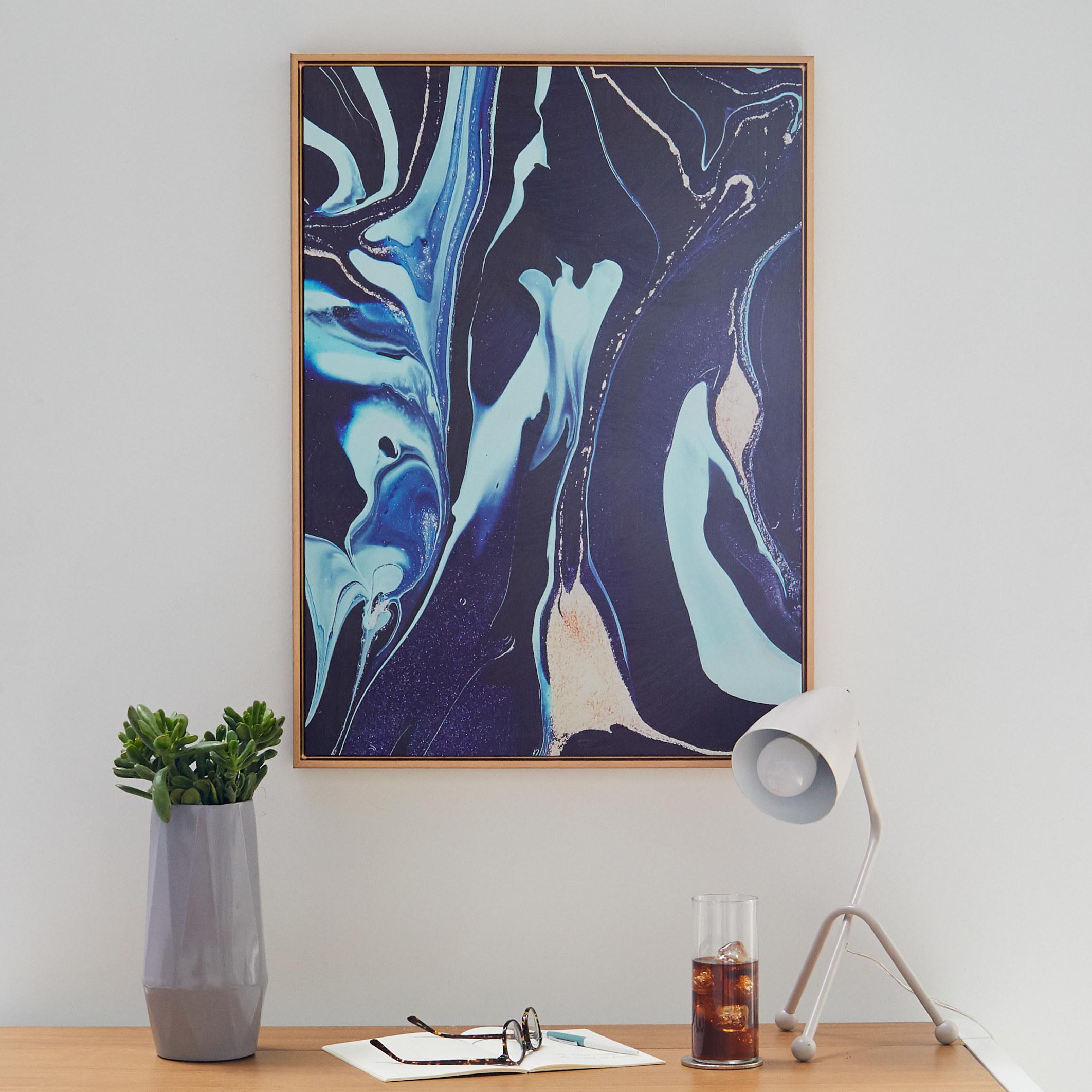 A framed print of a dark blue and light blue marble design