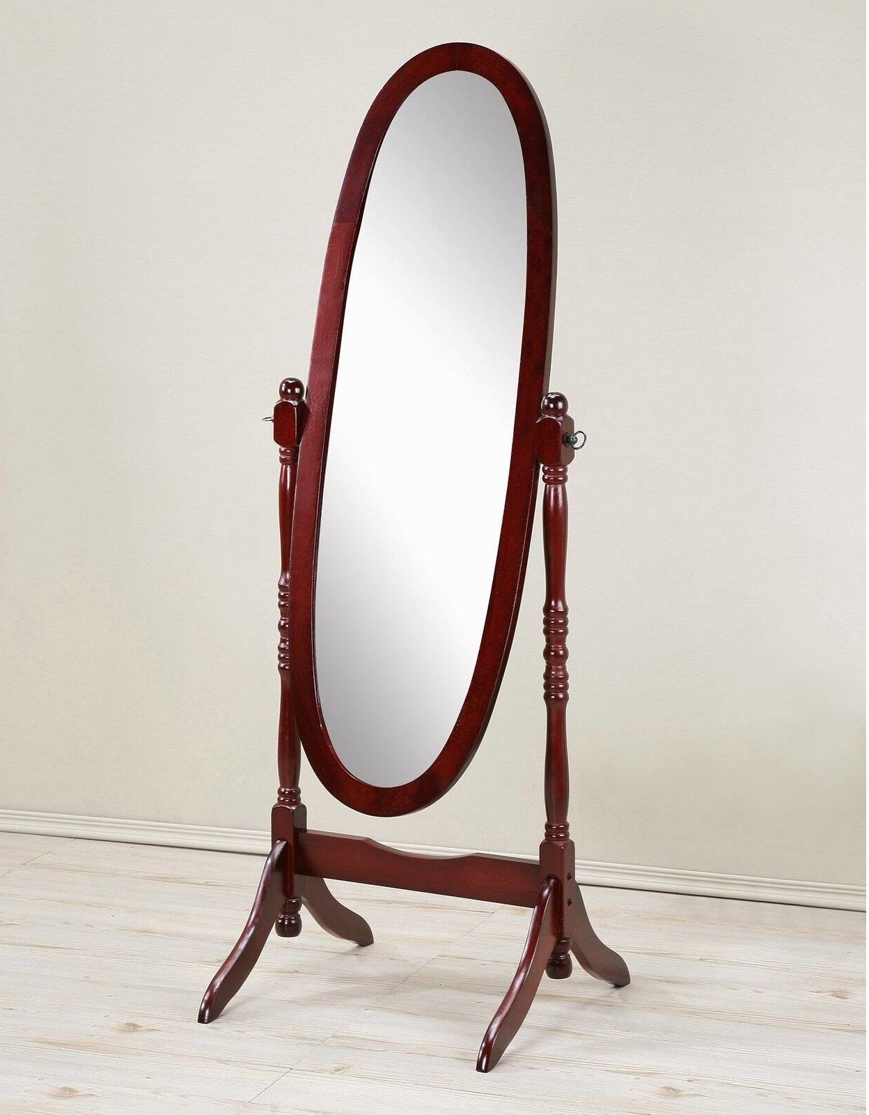 An oval mirror with a cherry wood frame and legs
