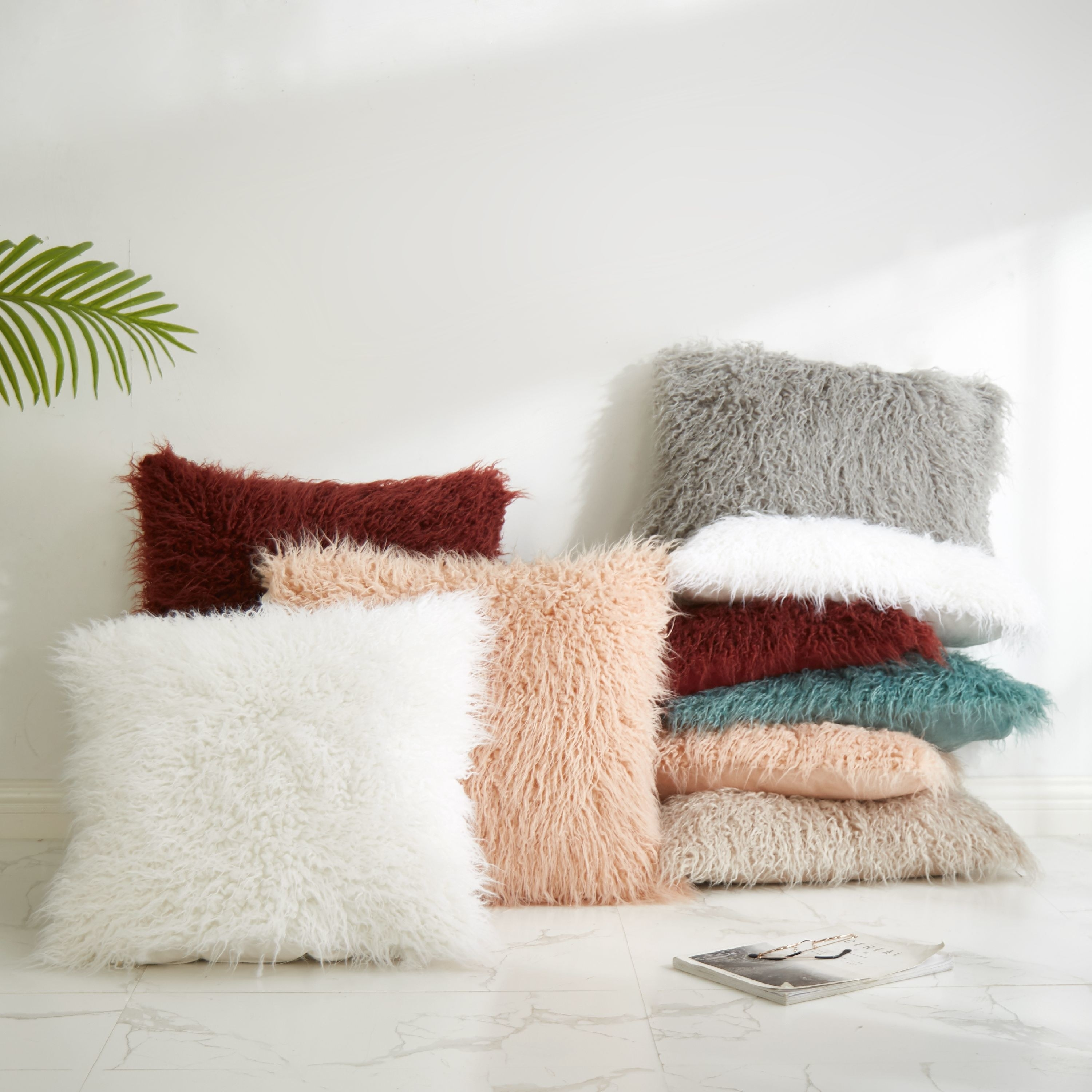 Super furry square pillows in various including white, gray, pink, seafoam green, and maroon.
