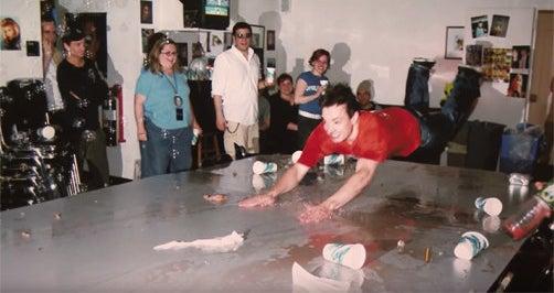 Jimmy Fallon sliding across the table of spilled drinks