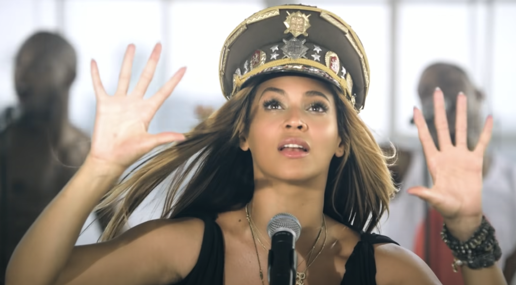 Queen Bey looks up dreamily in the Love on Top video