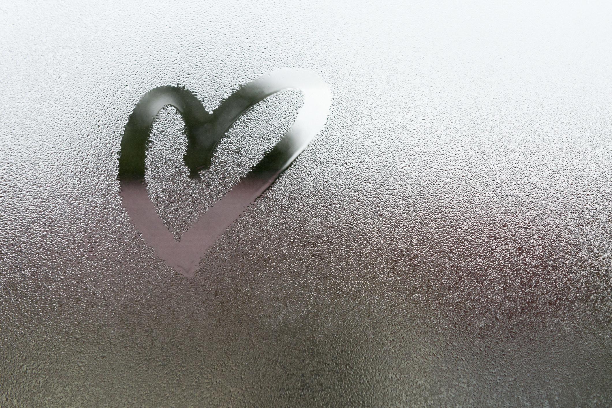 A heart drawn on breathe on a window