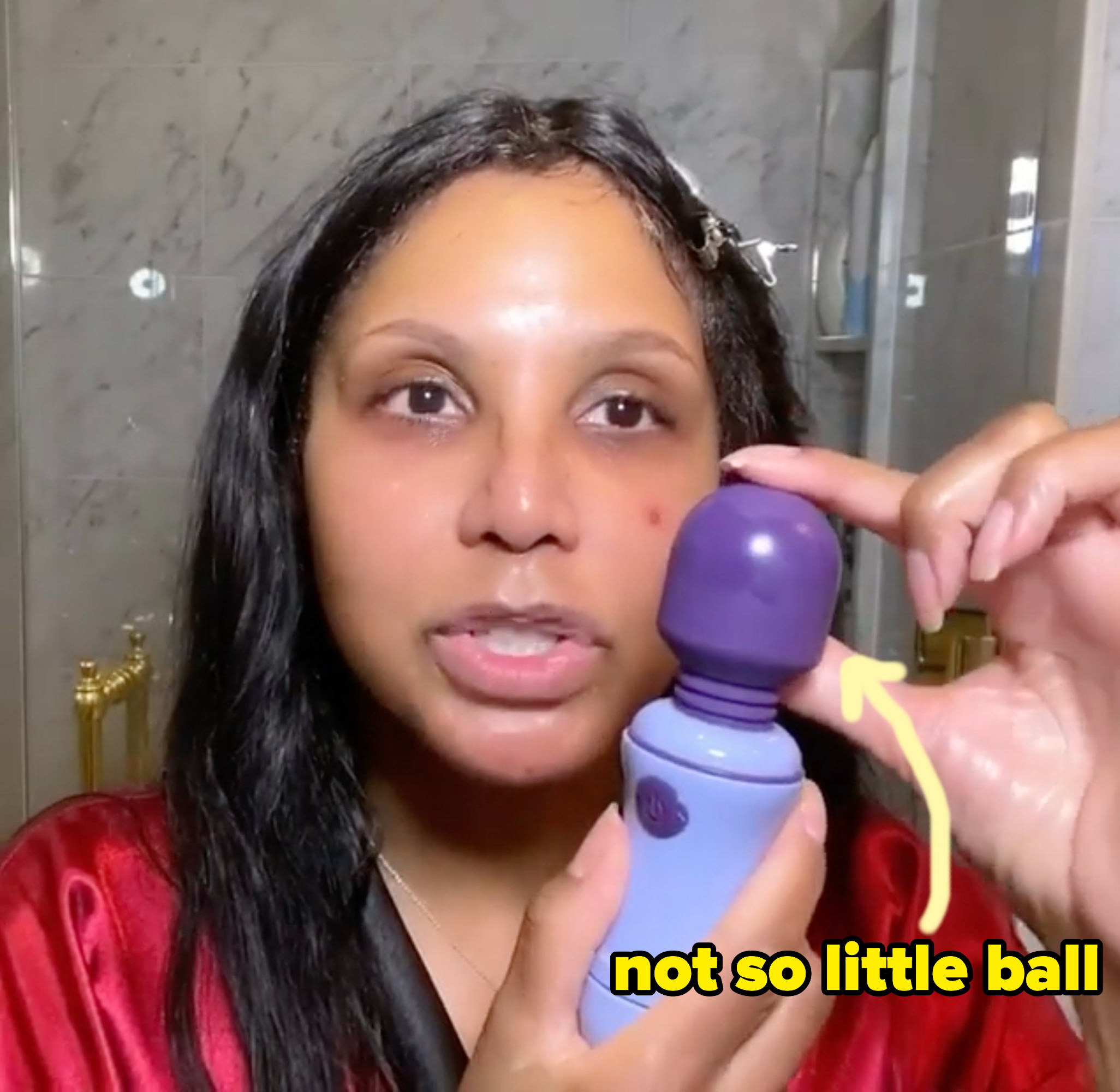 Toni touching the ball on her vibrator