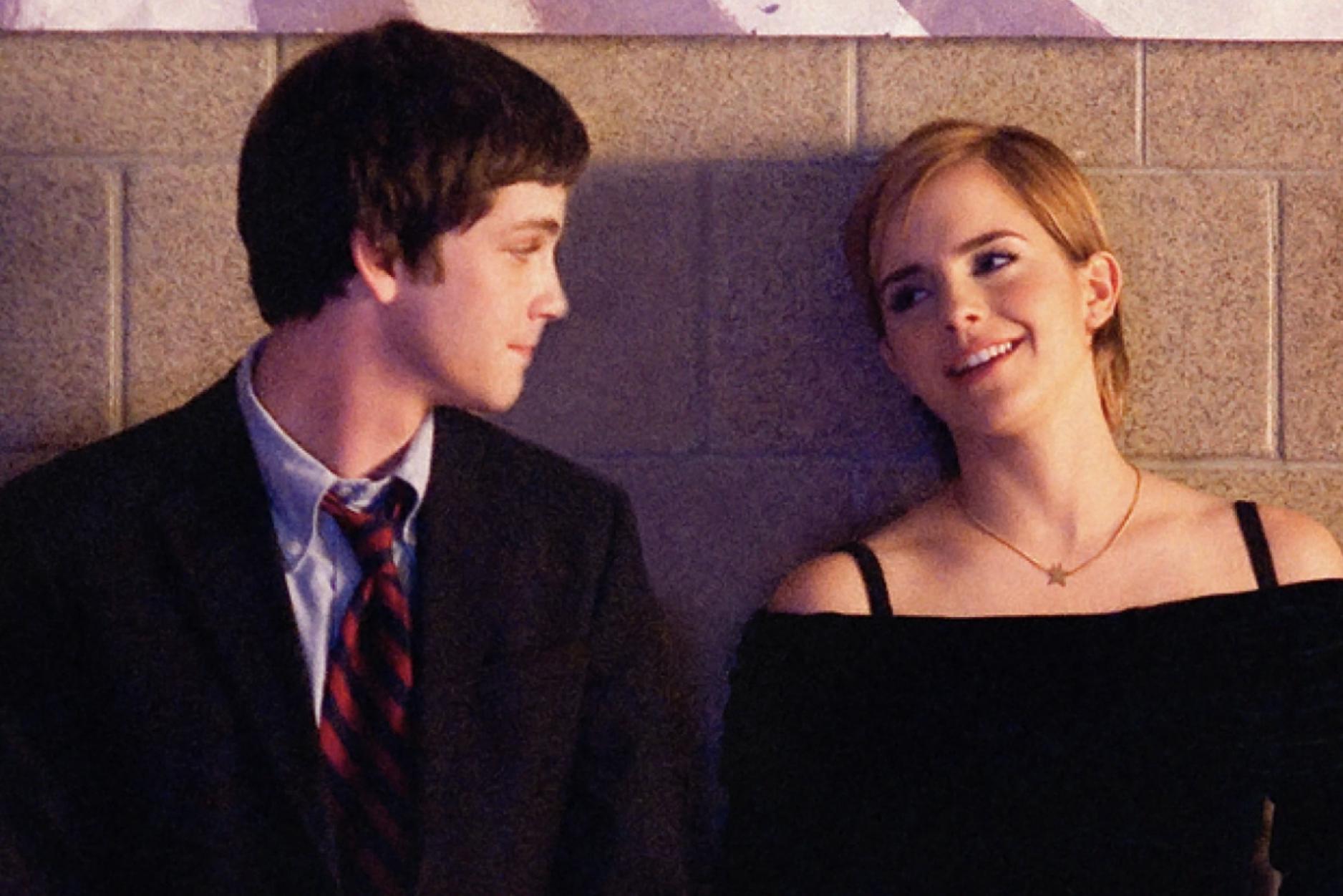 "Logan Lerman as Charlie and Emma Watson as ""Sam"" being wallflowers at a dance"