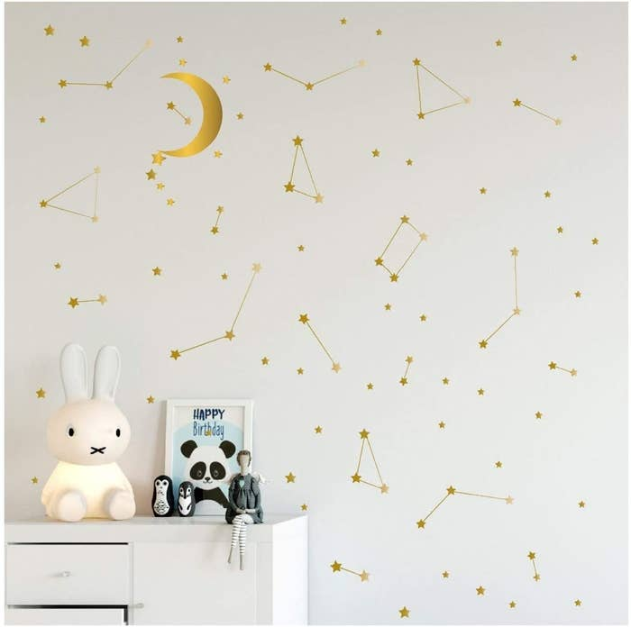 A wall covered in metallic star and constellation decals