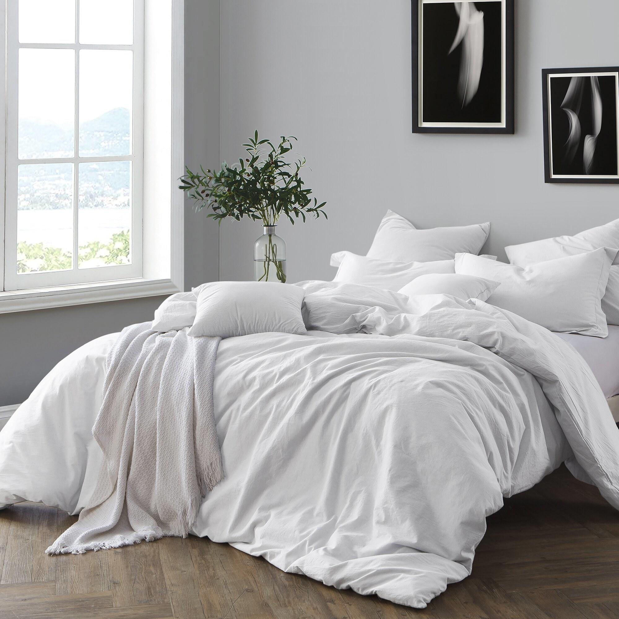A white duvet set on a bed