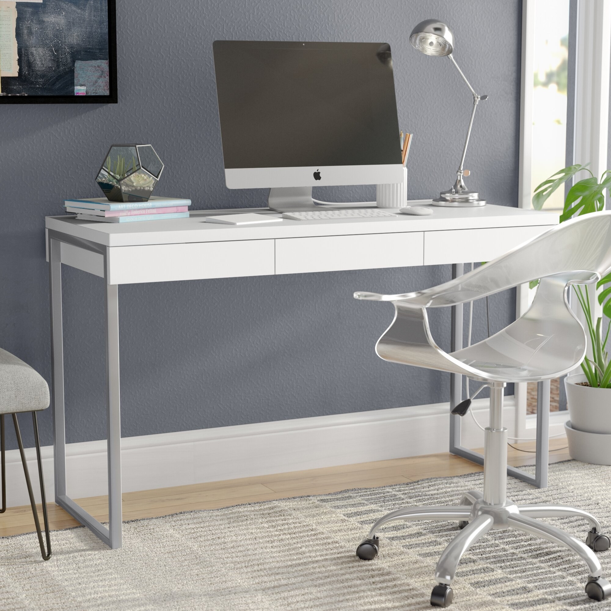 A white desk with silver legs and three little drawers