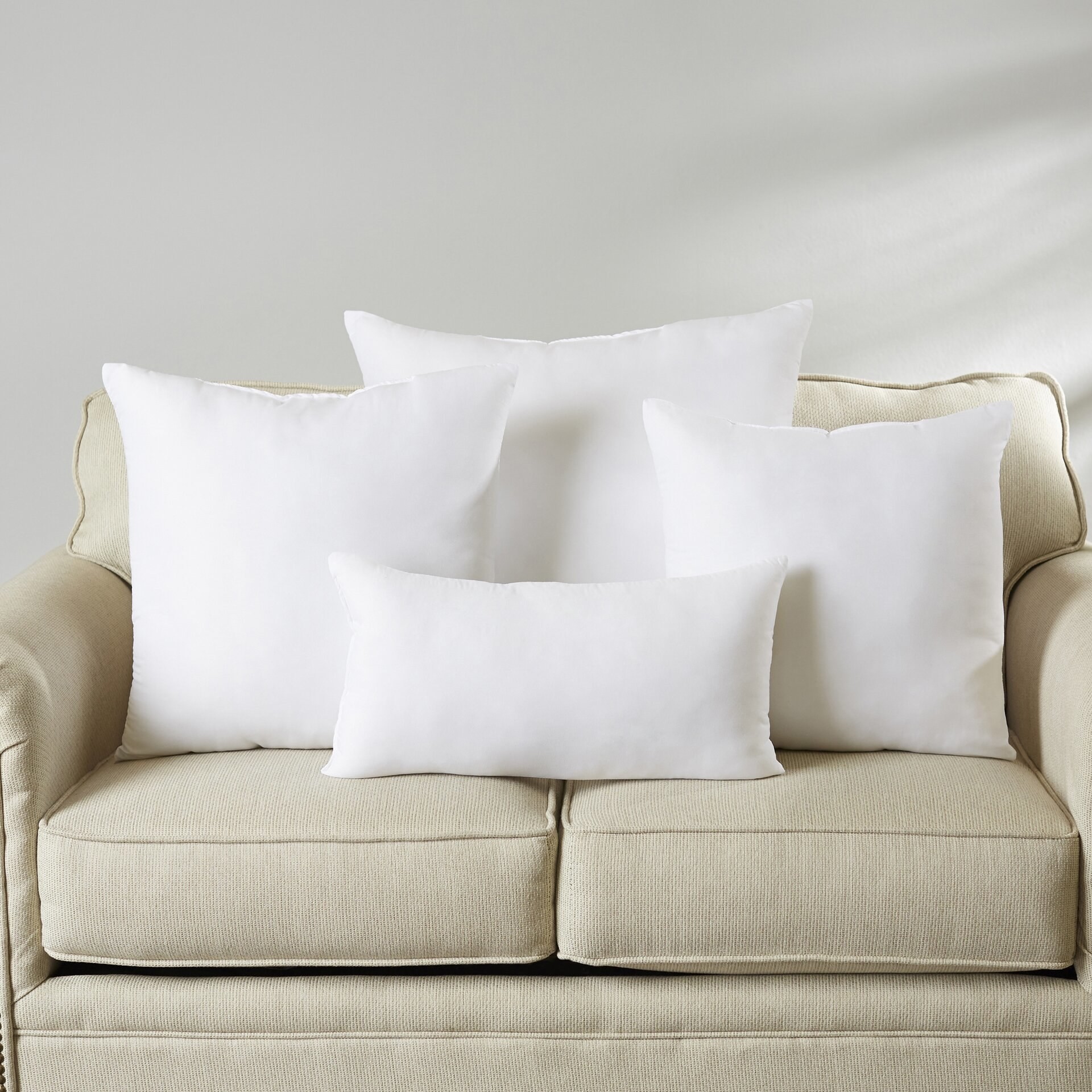 White pillow inserts in square and rectangular shapes