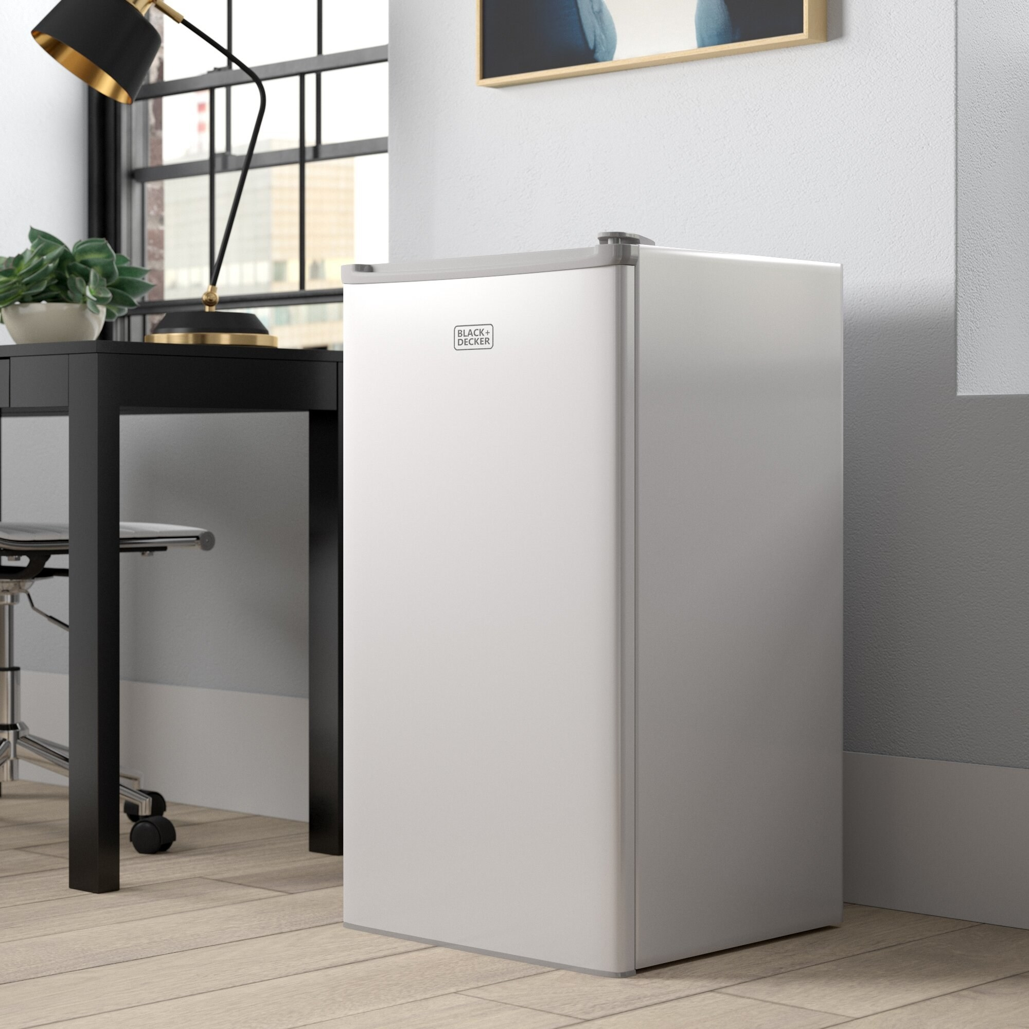 A white mini fridge propped next to a desk