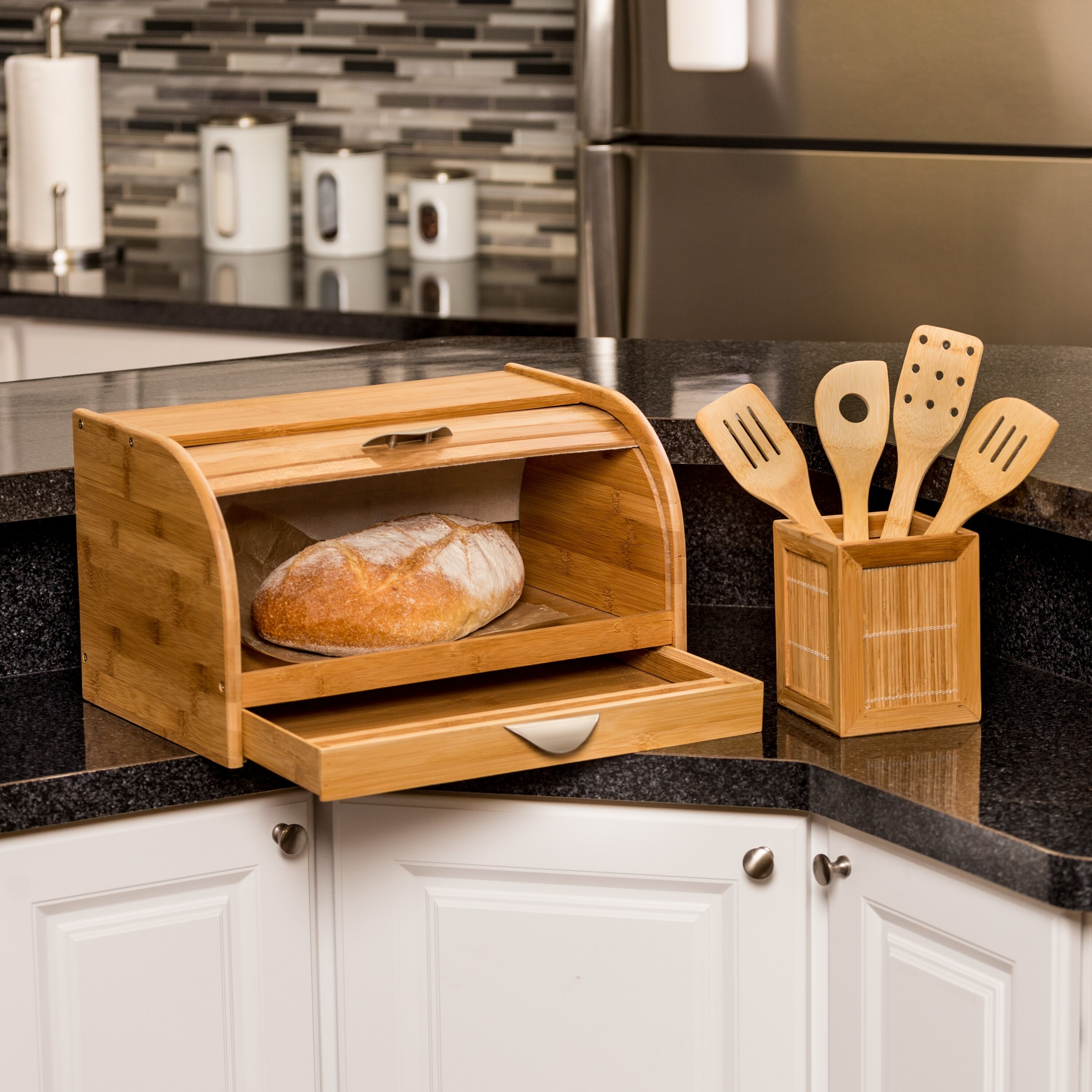 Wooden bread box with a slide up and down compartment and a small drawer underneath for storage
