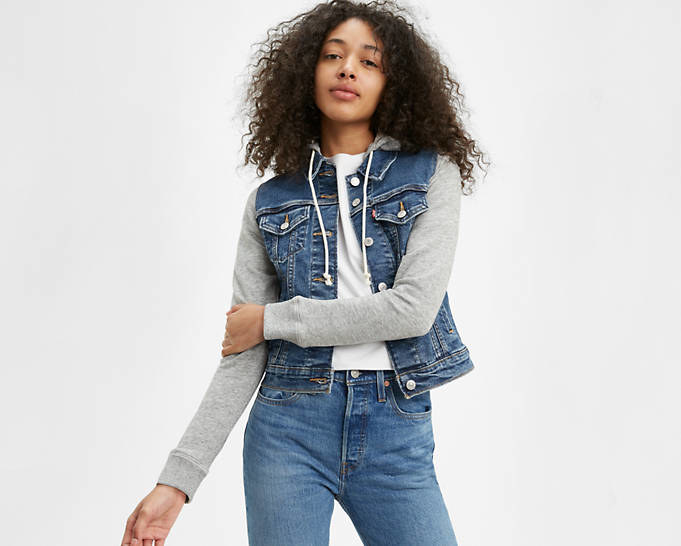 Model wearing the jacket in dark wash denim with gray sweatshirt sleeves and a good