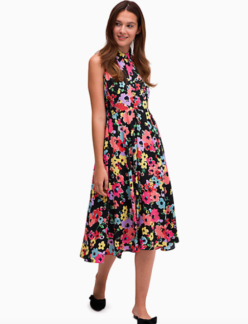 A model wearing the floral bouquet midi dress.