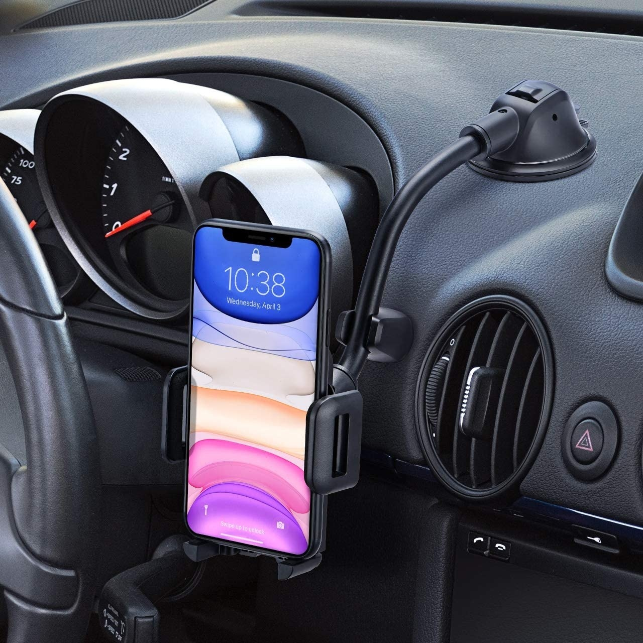 A phone mount suctioned onto a car dashboard