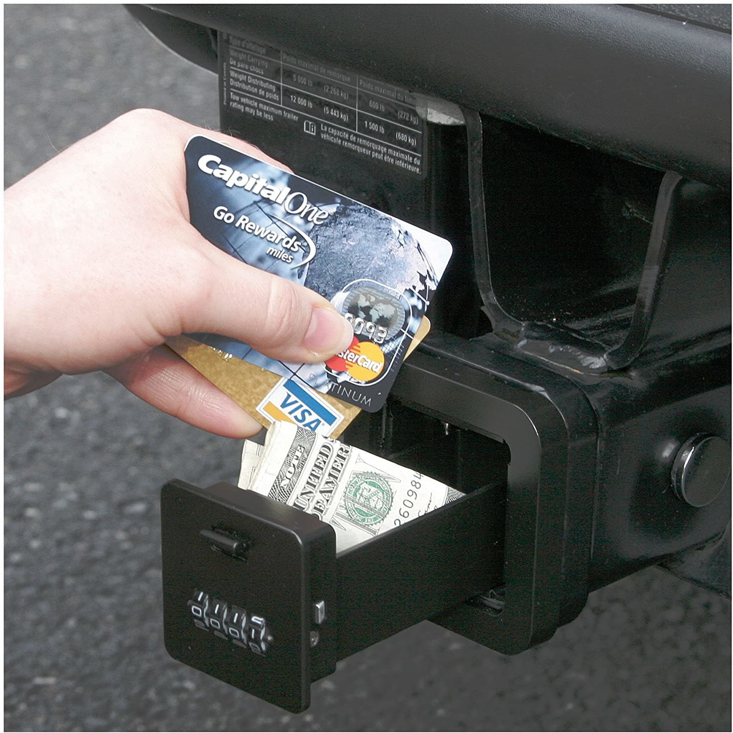 A person putting credit cards and money into their safe
