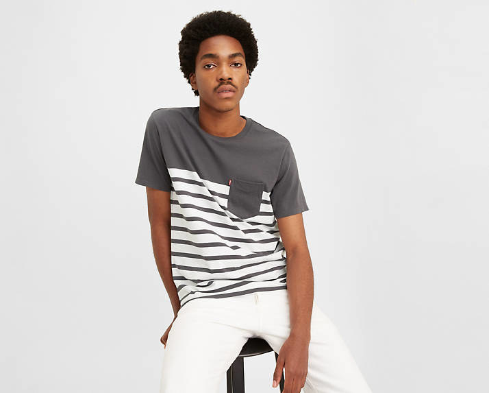 Model wearing the white and gray striped pocket T-shirt