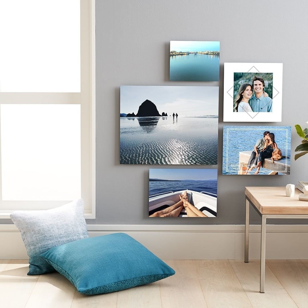 A gallery wall with different sizes of canvas prints