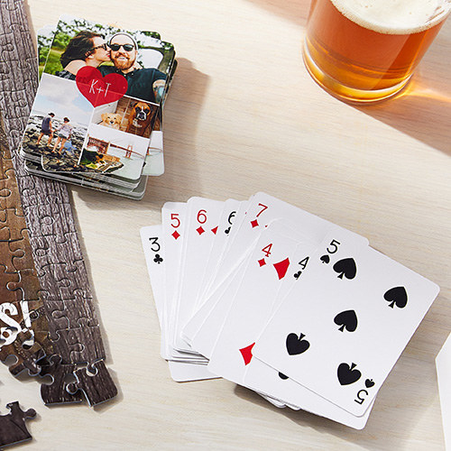 A deck of playing cards with a layout of photos on the back