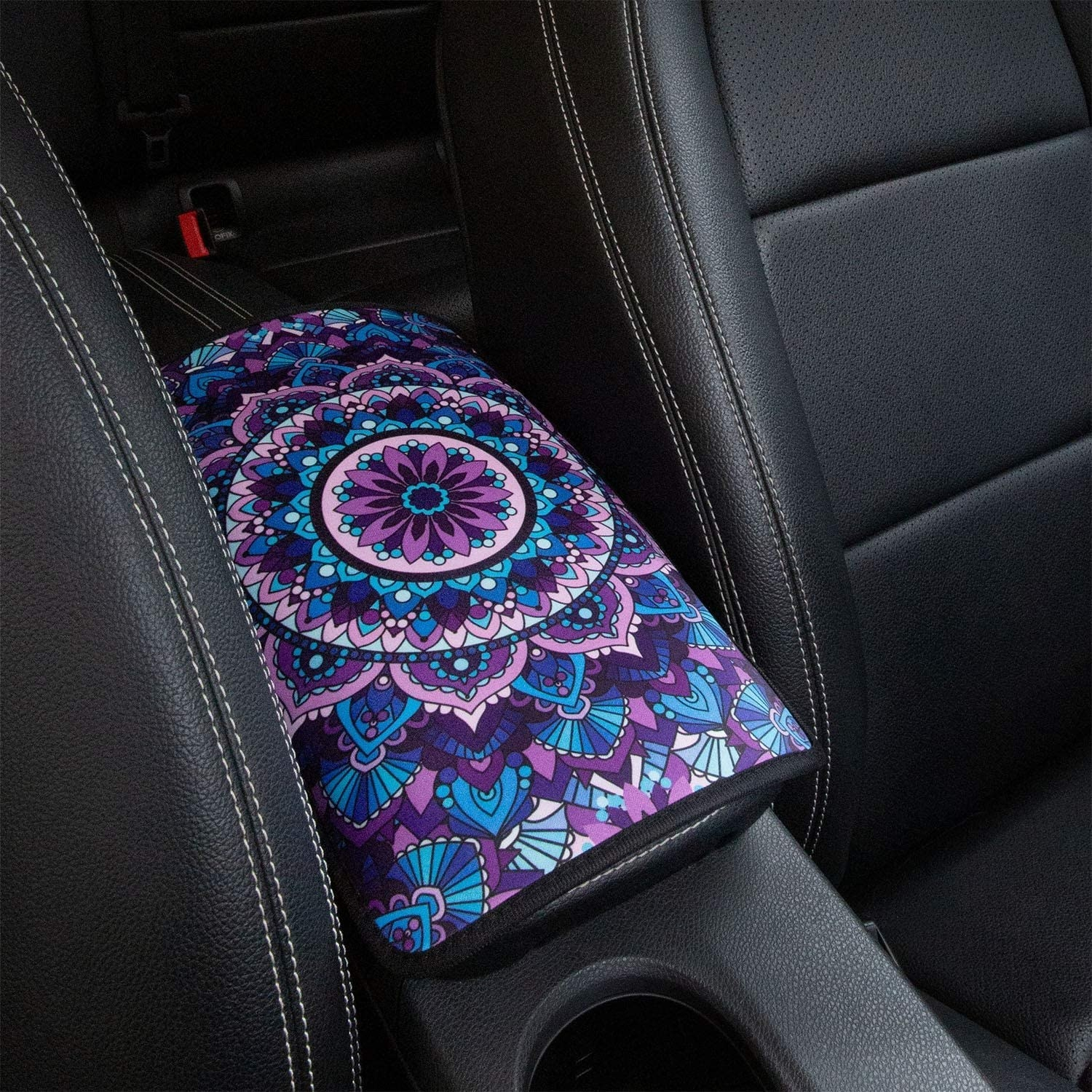 A patterned armrest attached to the centre console of a car