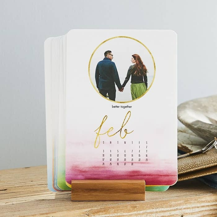Easel calendar with a watercolor ombre background and a circle layout design for one photo, plus dates for the month