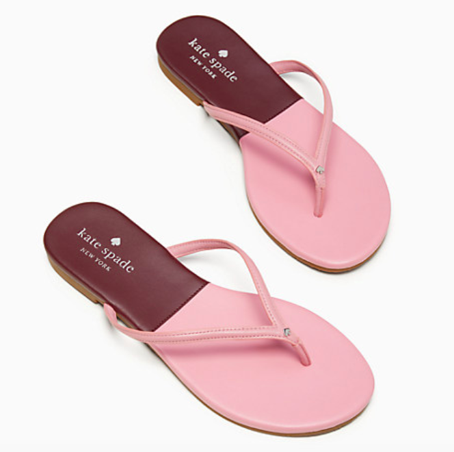 A pair of the cabana leather flip flops in pink/cherrywood.
