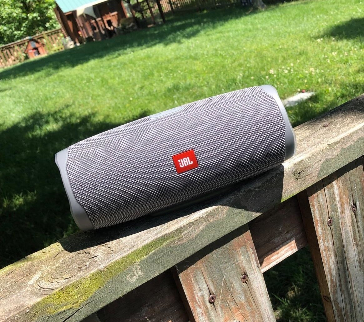 The cylindrical speaker in gray