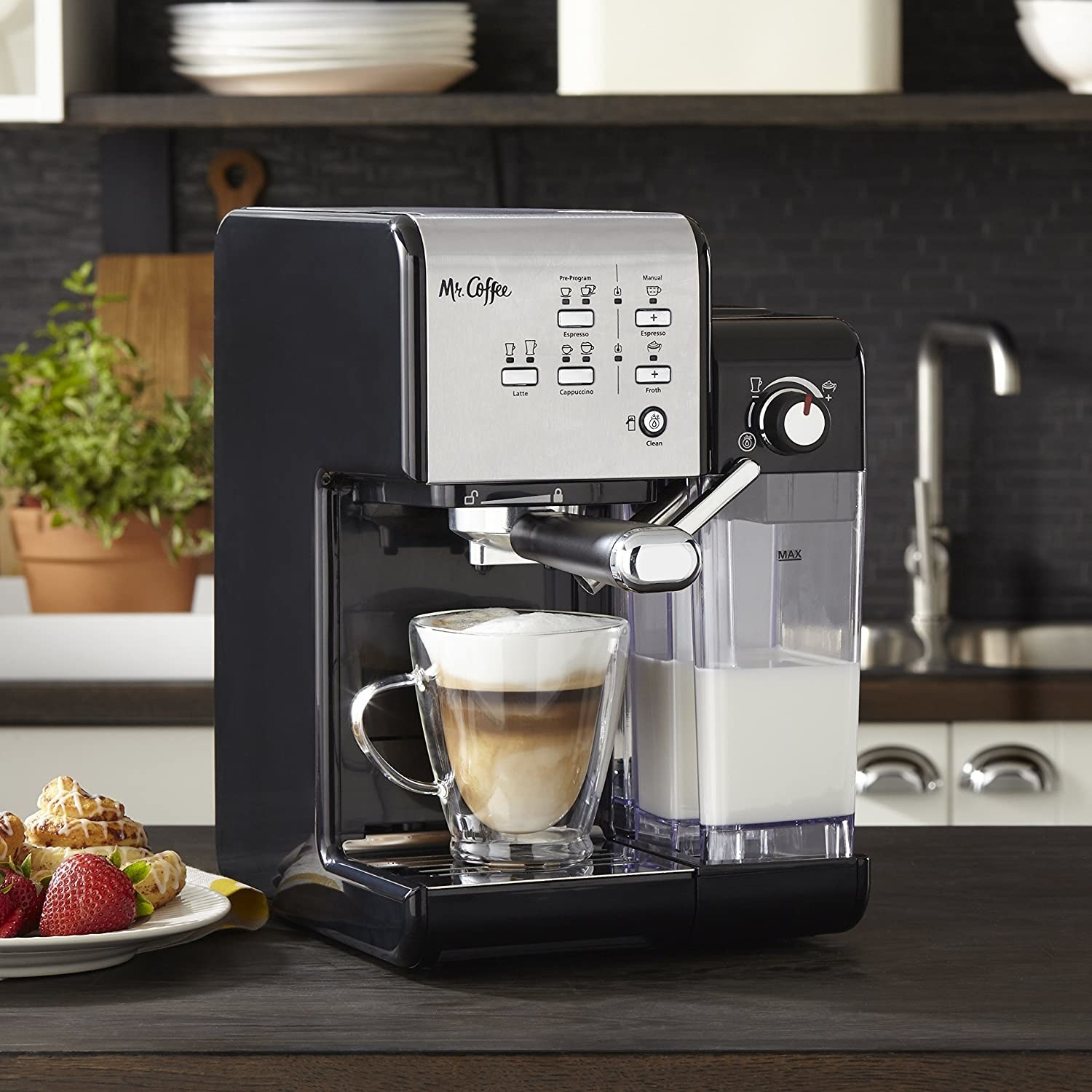 The machine, featuring simple button controls, a portafilter, and water and milk reservoirs