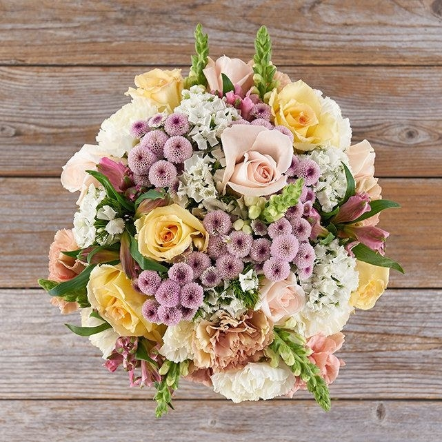pink, yellow, and white flower bouquet