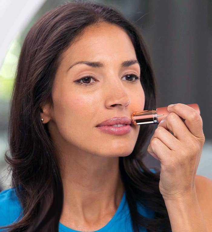 A person using the tool to remove hair from their upper lip