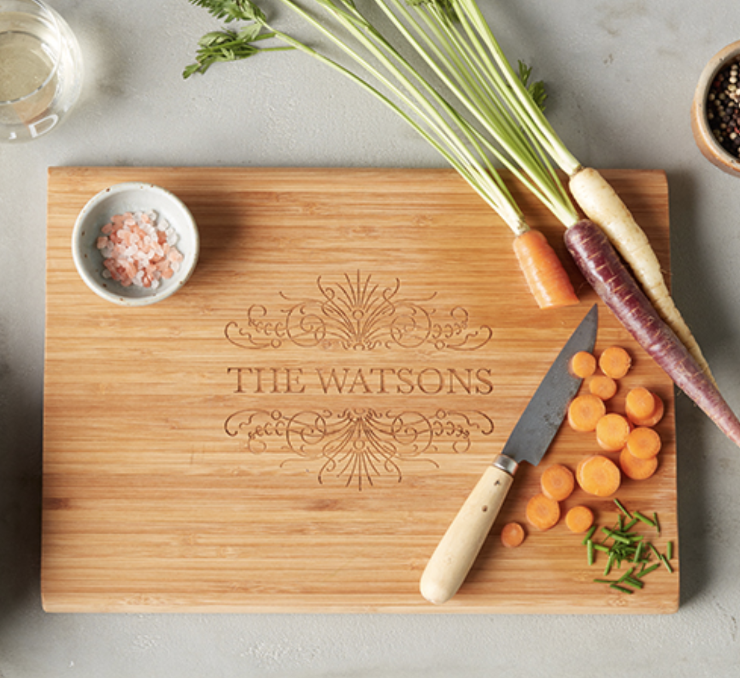 """Customized cutting board with """"The Watsons"""" engraved in the middle"""