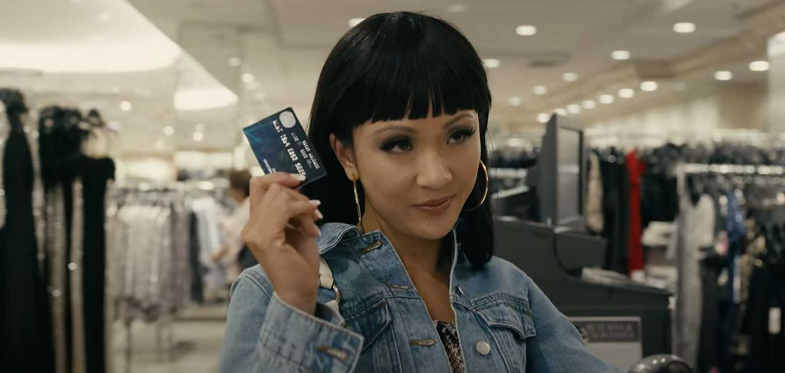 Constance Wu wearing a wig with huge bangs
