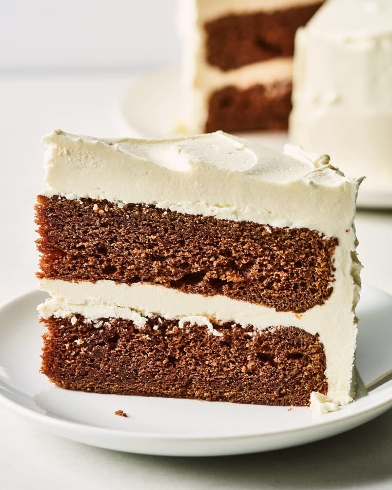 Slice of mahogany cake with creamy frosting