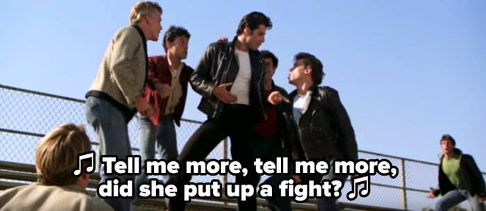 "Kenickie singing: ""Tell me more, tell me more, did she put up a fight?"""