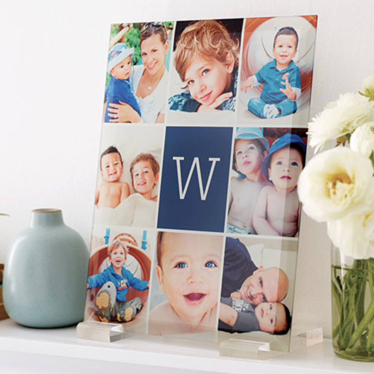 A glass print with eight photos and a monogram letter in the middle