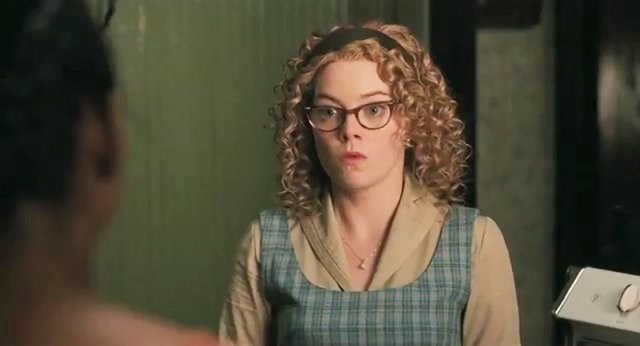 Emma Stone in an obvious curly wig