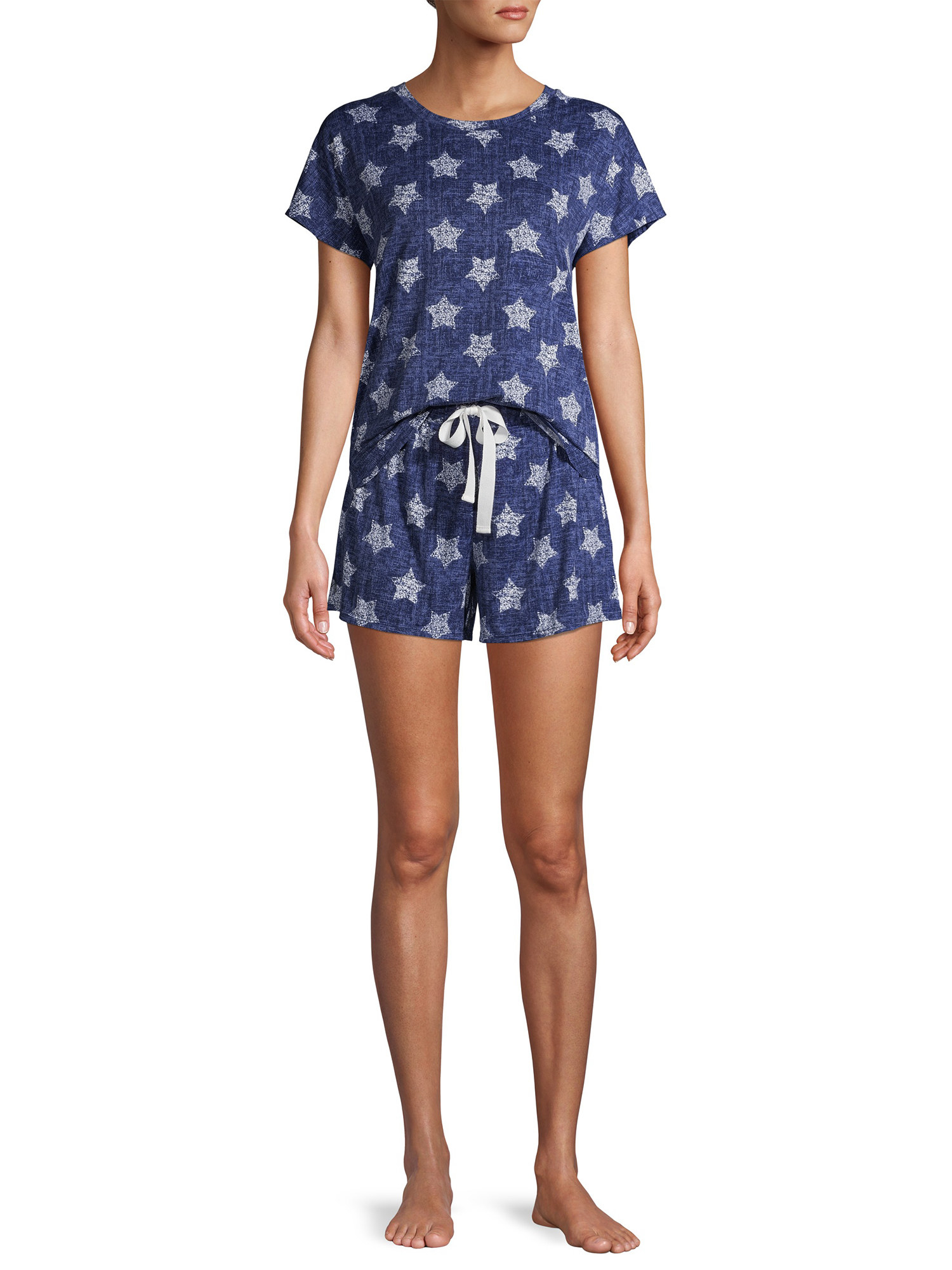 a model in the pajama set which is blue and covered in white stars