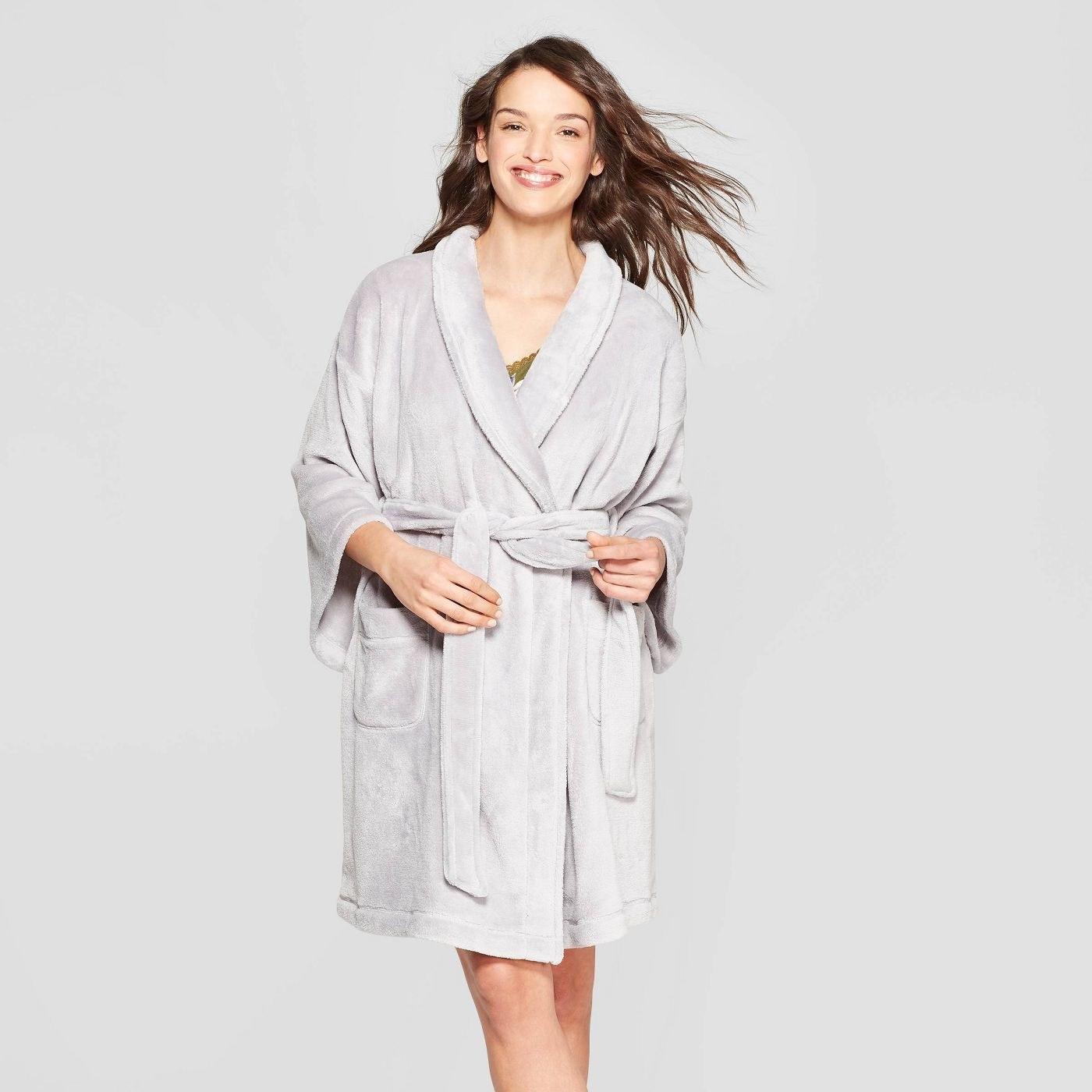 Model wearing gray fleece robe