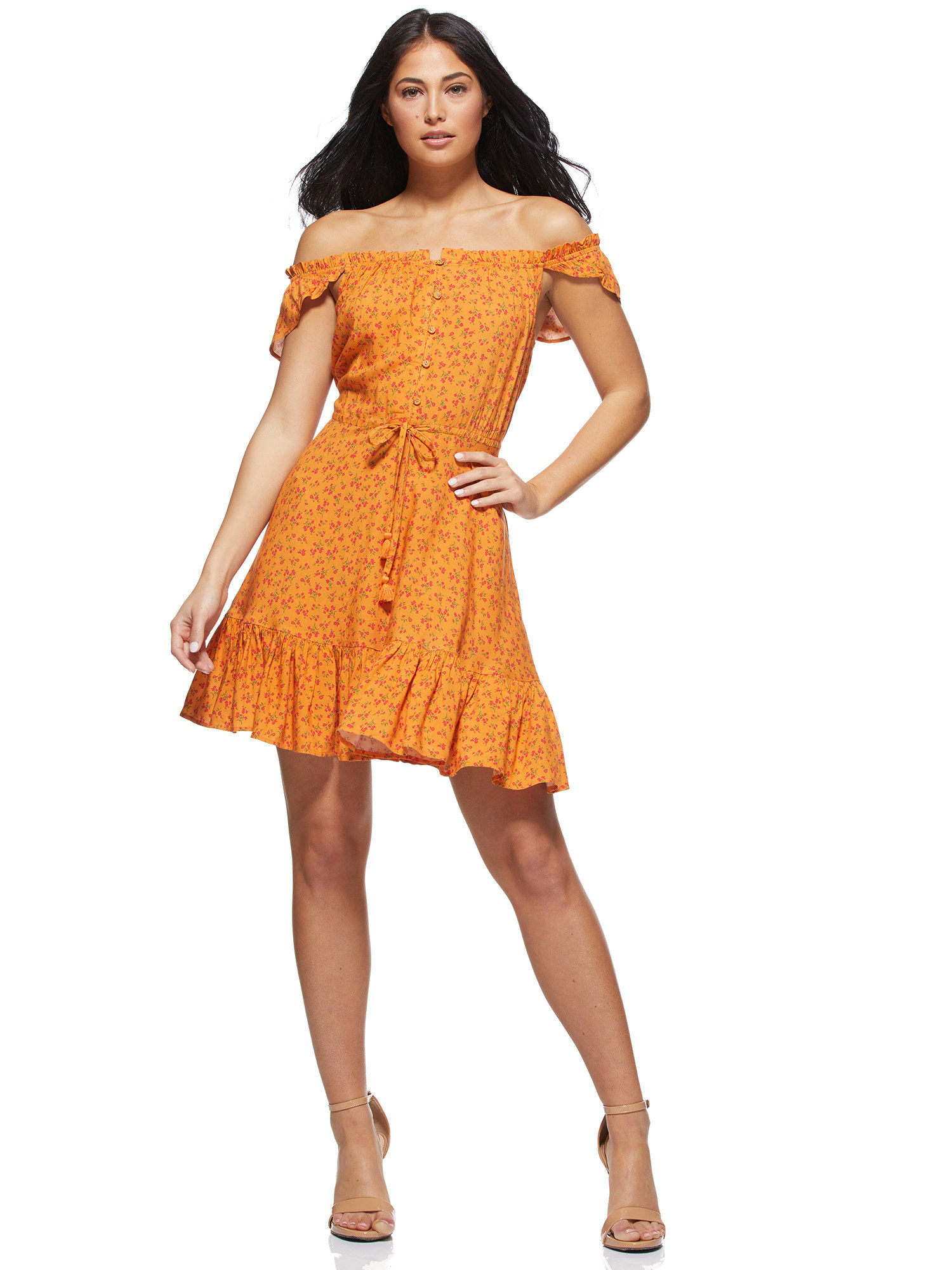 a model in the dress in yellow with tiny florals on it in orange