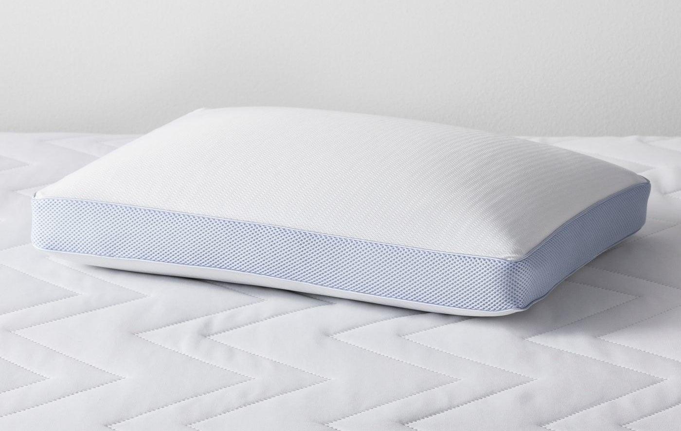 White memory foam pillow on top of a white mattress