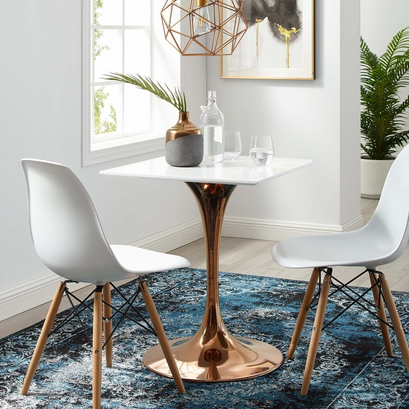 small table with rose gold leg with matching chairs