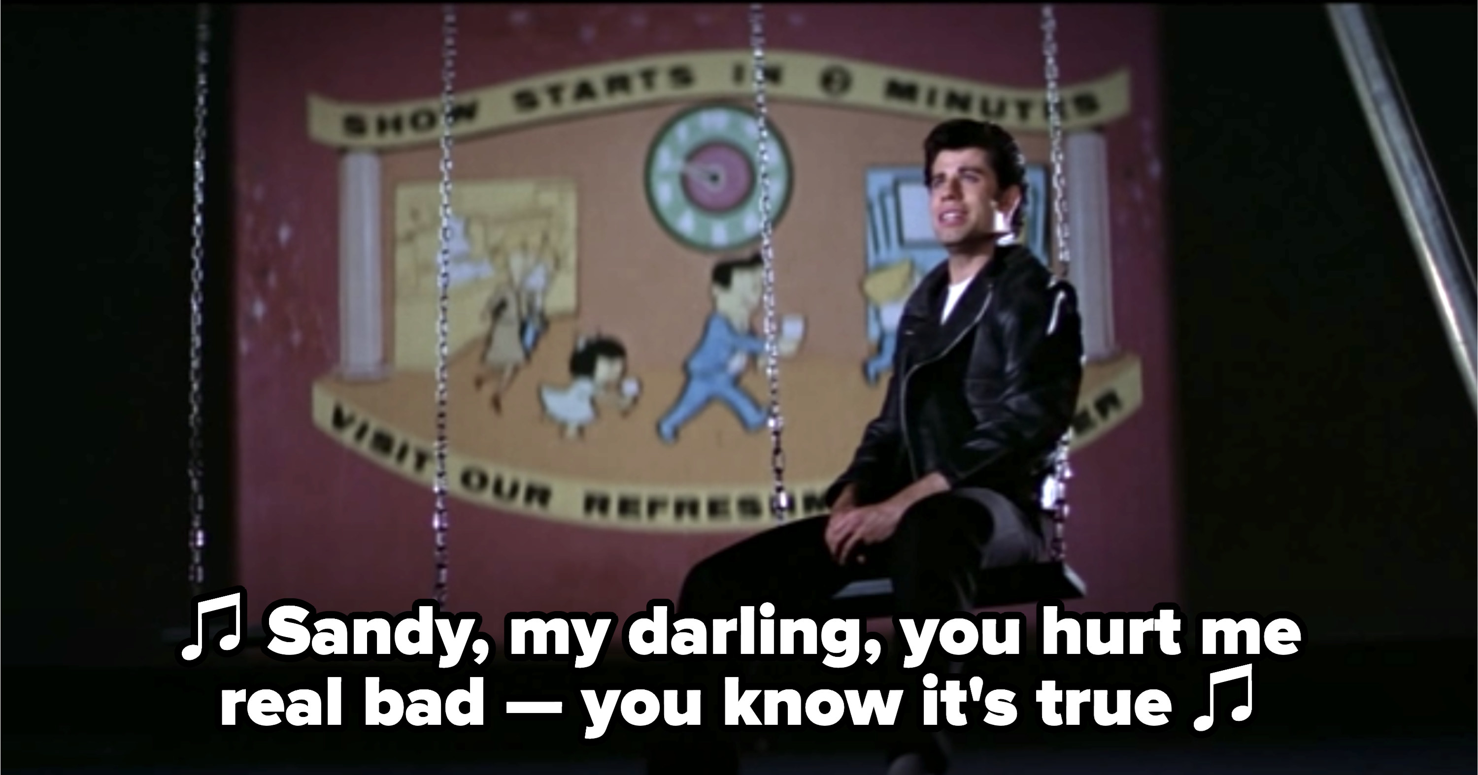 "Danny singing on a swing: ""Sandy, my darling, you hurt me real bad -- you know it's true"""