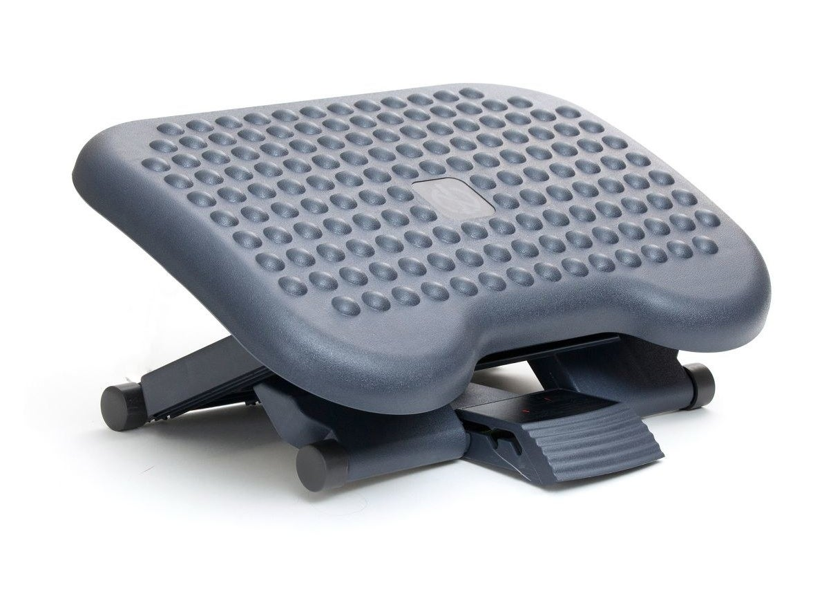 Gray foot rest with an adjustable height and tilt
