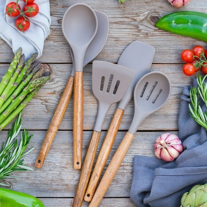 Five-piece silicone utensil set in gray and wood