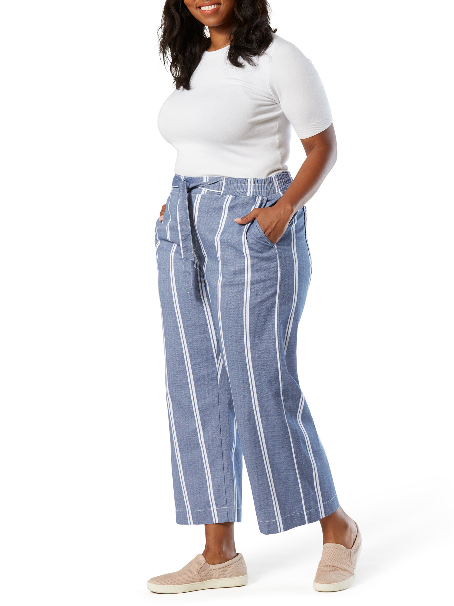 a model in blue linen pants with vertical white stripes