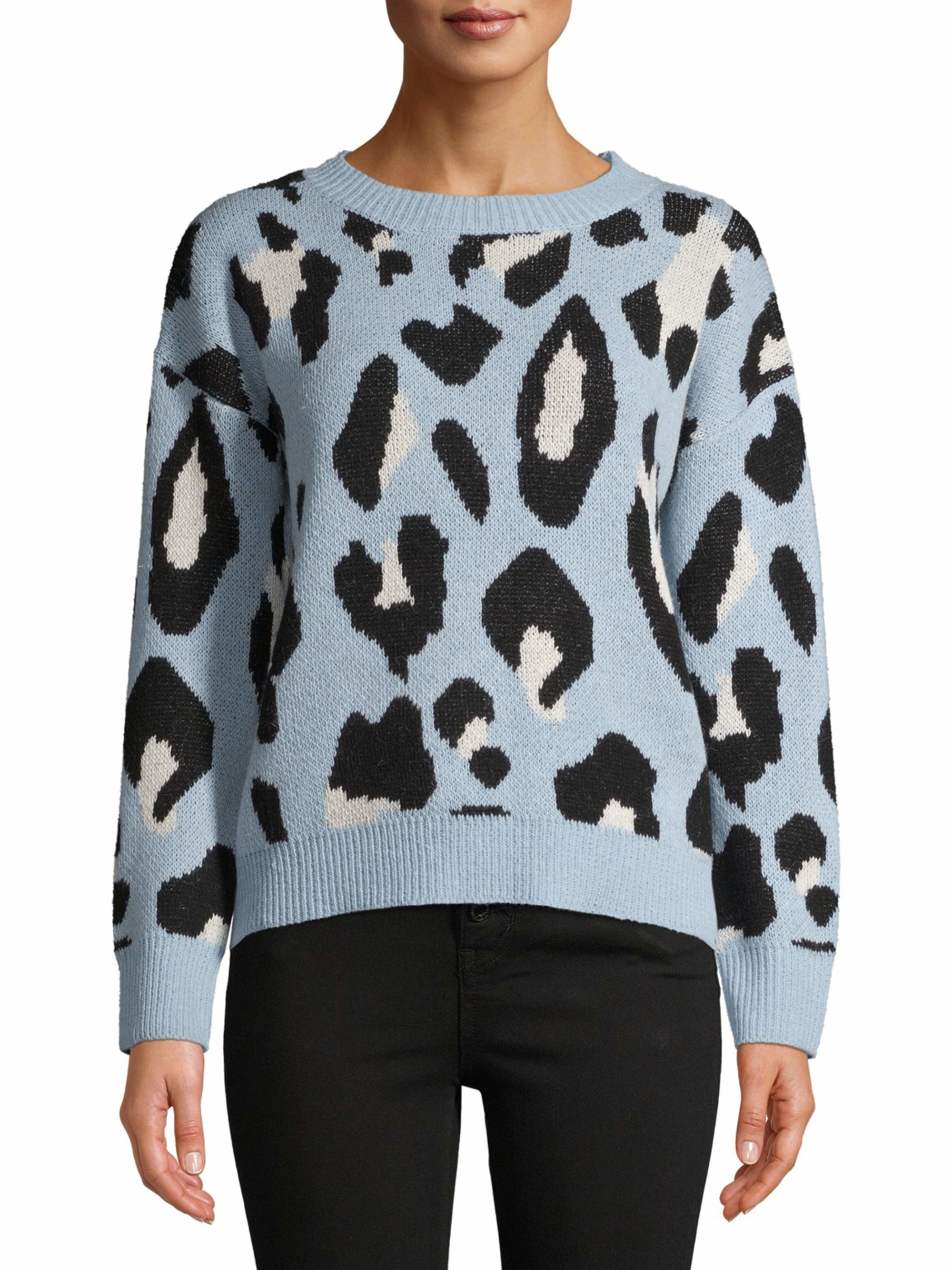 a model in the leopard print sweater in light blue with black and white spots